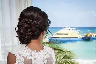 romantic bridal loose curly bun and braid